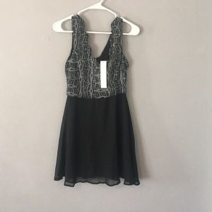 Black cocktail dress with sequined top